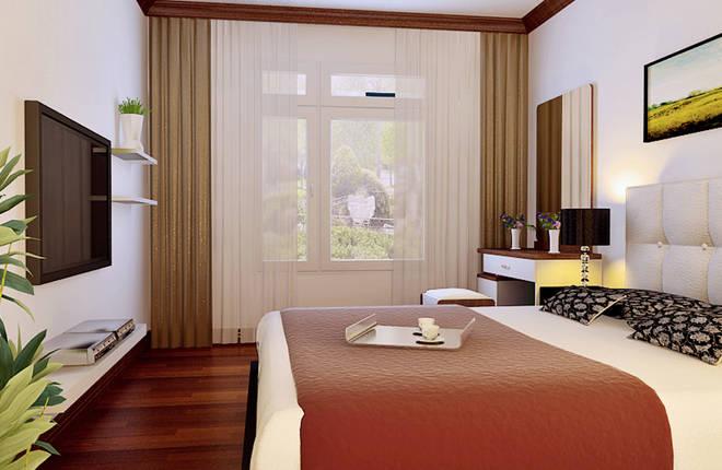 电视背景墙以壁纸木线条相结合,并且与沙发背景相呼应,使空间更加丰富